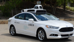 Uber pushes for self-driving cars after losing $900 million