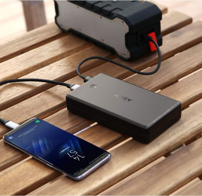Aukey portable charger charging an iPhone