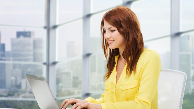 people, business and technology concept – smiling young woman wi