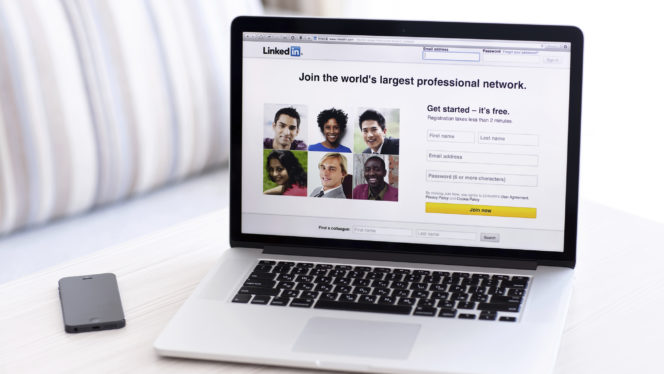 MacBook Pro Retina with LinkedIn home page on the screen