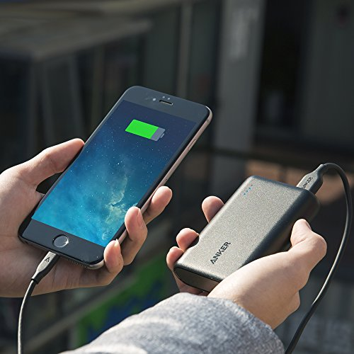 Charging an iPhone with an Anker 10000 portable charger.